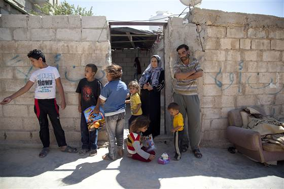 Khaled Al-Ali, 40, his wife, Sohailah, 31, and their six kids, Reda, 11, Ayah, 10, Samira, 8, Mohamed, 5, Fatima, 3, and Qasem, 1, escaped to Jordan in January 2013 from Aleppo, Syria. They have spent five months in Mafraq, Jordan. This is their one-room home. (Sumaya Agha for Mercy Corps / Sumaya Agha for Mercy Corps)