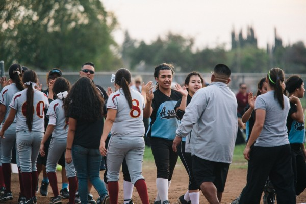 their opponents, the Ontario Jaguars, after the game. The Jaguars won. Photo Credit: Laura Kleinhenz for Al Jazeera America